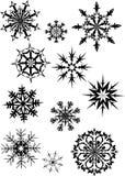 Black snowflakes on white Stock Images