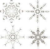 Black snowflakes on a white background Royalty Free Stock Image