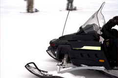 Black Snowmobile. A black snowmobile speeding across open snow Royalty Free Stock Photos