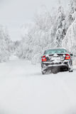 Black snowy car standing on winter road Royalty Free Stock Photo