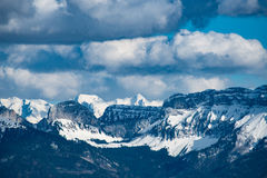 Black Snowy Mountains Under Cloudy Sky during Daytime Royalty Free Stock Images