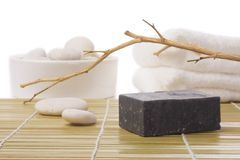 Black soap on bamboo mat Royalty Free Stock Photography