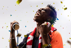 Black Soccer fan in action emotions confetti. Black Soccer fan in action emotions isolated Royalty Free Stock Images