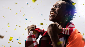 Black Soccer fan in action emotions confetti Stock Photography