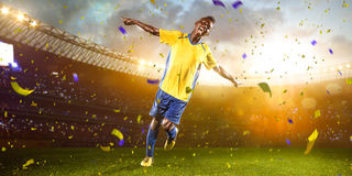 Black soccer player in action. Stadium field Stock Photography