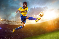 Black soccer player in action. Stadium field Stock Photo