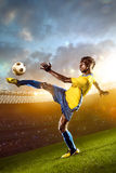 Black soccer player in action. Stadium field Stock Images