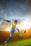 Black soccer player in action. Stadium field Royalty Free Stock Photo