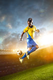 Black soccer player in action. Stadium field Royalty Free Stock Photography