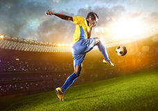 Black soccer player in action. Stadium field Royalty Free Stock Photos