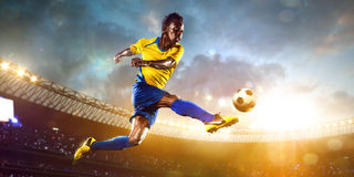 Black soccer player in action. Stadium field Stock Image