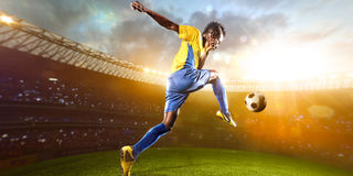 Black soccer player in action. Stadium field Royalty Free Stock Image
