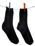 The black socks. Made of a clap, hang on a cord Stock Photography