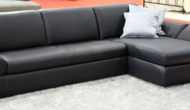 Black sofa. Black leather sofa with pillows Royalty Free Stock Photography