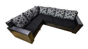 Black sofa. Isolated, modern, corner sofa, upholstered in black leather and textile. Pillows designed in vintage flower style Stock Photography