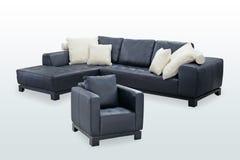 Black sofa. On bluish gradient Stock Image