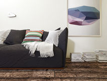 Black Sofa with Cushions in Room with Wood Floor Stock Photo