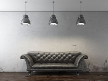 Black sofa in front of grunge wall Royalty Free Stock Photos