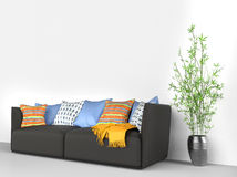Black sofa with lots of stuff on it Royalty Free Stock Images