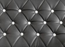Black sofa upholstery leather pattern background Royalty Free Stock Image