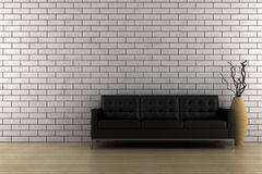 Black sofa and vase with dry wood Stock Photo