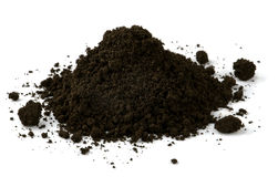 Black soil. Pile of black fertile soil isolated on white Stock Photo