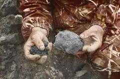 Black soil for planting  in man hands Stock Photo