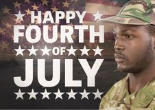 Black soldier against american flag for independence day Royalty Free Stock Photos