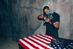 Black soldier checks his weapon Stock Images