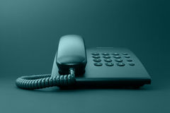 Black solid office phone Royalty Free Stock Photos