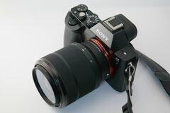 Black Sony Dslr Camera on White Surface Royalty Free Stock Image