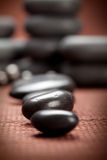 Black spa stones. On brown background Stock Image
