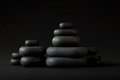 Black spa stones. On black background Stock Photo