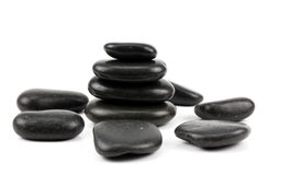 Black spa stones isolated on white Royalty Free Stock Images