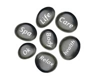 Black spa stones isolated on white. Background Royalty Free Stock Photography