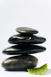 Black spa stones with leaf Royalty Free Stock Photography