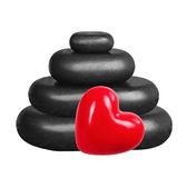 Black spa stones and red heart isolated on white. Background Stock Photo
