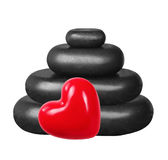 Black spa stones and red heart isolated on white Royalty Free Stock Images