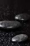 Black spa stones with water drops Stock Photo