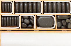 Black spa zen massage stones in wooden case blank copy space Stock Images