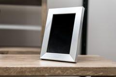 Black space on vertical silver aluminum frame Stock Photos