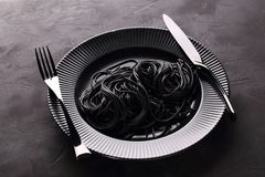 Black pasta in the black plate Royalty Free Stock Image