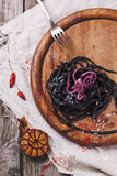 Black spaghetti with octopus Royalty Free Stock Photos