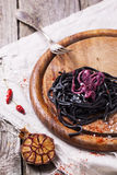 Black spaghetti with octopus Stock Images