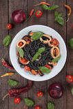 Black spaghetti pasta with mussels and squid rings Royalty Free Stock Photo