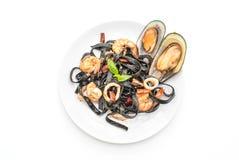 black spaghetti or pasta with seafood Stock Photos