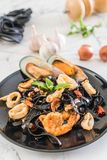Black spaghetti or pasta with seafood Stock Images
