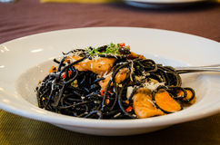 Black spaghetti with salmon Stock Photos