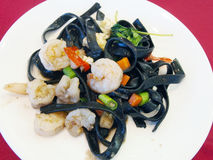 Black spaghetti with seafood. Stock Photo