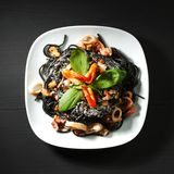 Black spaghetti with seafood Royalty Free Stock Photo